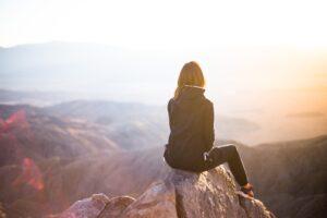 Girl on mountain top (image)